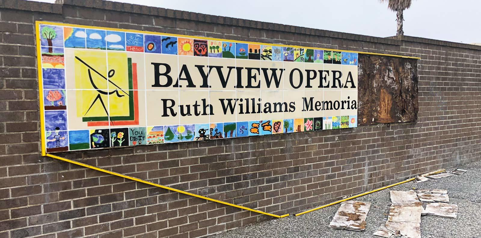 Broken Ruth Williams Memorial Theatre tile sign